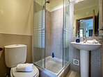 A bathroom with a shower cubicle designated for the twin bedroom