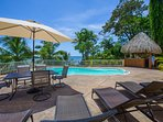 Pool area with lounge chairs and outdoor table, chairs and our TIKI Bar!