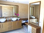 Master Bathroom with twin sinks, dressing table and private toilet.