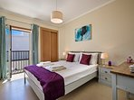 A master bedroom with an en suite and a balcony overlooking a quiet street
