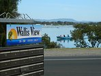The sign says it all. Blue skies, sunshine, crystal clear water and fish. All at your doorstep.