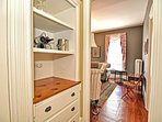 A butler's pantry sits between the parlor and the dining roo