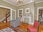 The formal parlor is just beyond the living room.