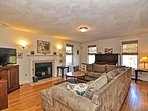 Living Room 1:  Large sectional couch, flat-screen TV, piano, an