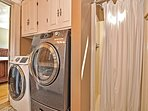 Ensuite Master bath with shower and laundry machines.