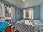 This light blue bedroom offers a queen bed for 2.