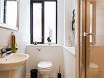Shared bathroom, toilet, sink, shower