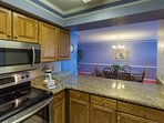 Well equipped kitchen has full size appliances, everything needed for meal preparation.