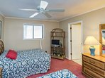 Second bedroom has two double beds and TV.  Beds will be made when you arrive.