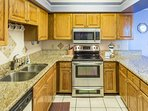 Plenty of granite counter space for meal preparation and serving