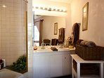 Downstairs Master Ensuite Bathroom with shower/tub combo
