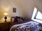 Dark Purple Room with queen bed