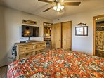 The master bedroom boasts a flat-screen cable TV and deck access.