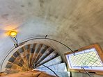 Take the spiral staircase to the second floor of the castle.