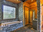 Beautiful stonework highlights all of the bathrooms.