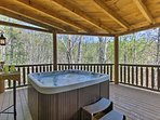 This 3-bed, 3.5-bath cabin boasts forest views and a private hot tub.
