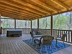The surrounding forest adds privacy during your stay.