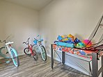 Access the 3 kid's bicycles or game table in the  back storage area.