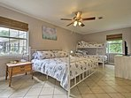 This spacious bedroom accommodates 5.