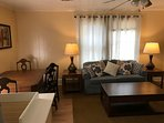 Upstairs common area has sleeper sofa and dining table.