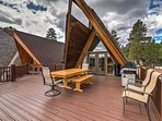 Enjoy a family barbecue on the deck with gas grill and outdoor furniture.