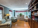 Library Room with TV, Doubles as Bedroom 4 with pull out Murphy Bed in White Cabinet.