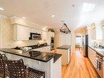 Chef's Kitchen, Prep Island, Double Ovens, Wine Cooler, Breakfast Bar