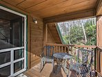 Sip your morning coffee on this covered deck space.