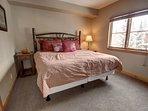 Guest bedroom on main floor with adjoining bathroom.