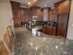 Modern kitchen with granite countertops.