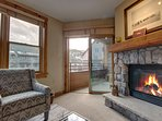 Cozy up to the fireplace after a long day of skiing.