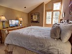 Big king bed in master bedroom to cozy up in after a long day out and about exploring all of Keystone areas.