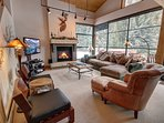 Vaulted ceilings in the living room to open up the area more. Come relax and play games and watch your favorite family...