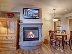 Cozy up by the fireplace after a long day of skiing.
