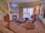Cozy couch by the fireplace to watch your favorite movie with the family.