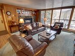 living area with big windows for natural lighting and great views of East Keystone's mountains.