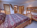 Bedroom with king bed and bunk beds. Great for two families coming at once to share the room with.