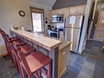 Great kitchen with bar stool seating