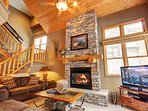 Beautiful stone fireplace and pine staircase
