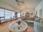 Kick back in the spacious living room with lofty ceilings.