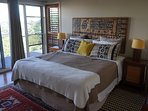 Spacious Master bedroom with super king bed and sliding doors to front balcony