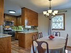The dining area flows seamlessly into the fully equipped kitchen.