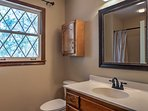 Natural light pours into the bathroom.
