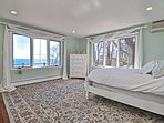 Bedroom 2: The Master suite with a Queen bed and ocean views.
