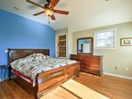 A bright blue wall highlights the master bedroom.