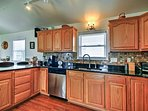 Wood cabinetry and floors give the kitchen rustic flare.