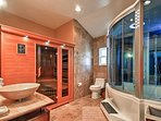 The incredible master bathroom features a sauna, steam room, and jetted shower!