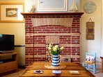 Original Norfolk brick fireplace and driftwood table