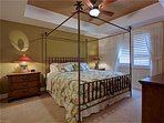 Master bedroom has a king-size bed, TV with cable, and a large master bathroom