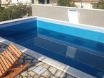 A furnished swimming pool with a beautiful view